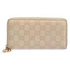 Gucci Beige White Guccissima Leather Zip Around Wallet