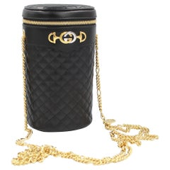 Gucci Belt bag / Cross body bag in black leather and gold chains.