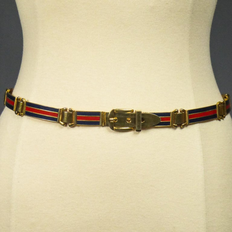 Circa 1980 Italy  Fine Vintage belt in brass and enamel with the logo of the famous colors of the Gucci House Designer of Florence in Italy and dating from the 1980s. Shiny polished golden brass with long enamelled links with red and navy blue