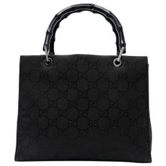 Gucci Black Bamboo Handle GG Canvas Bag