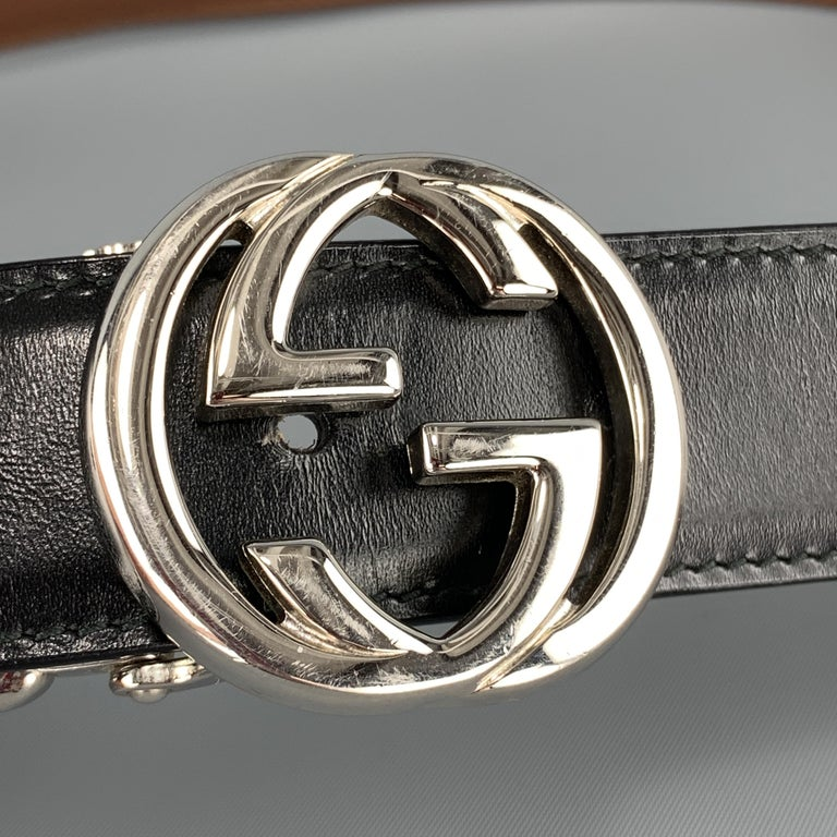 GUCCI dress belt features a black or brown reversible leather strap and a silver tone GG logo buckle. Missing brown loop and wear on buckle. As-is. Made in Italy.  Good Pre-Owned Condition. Marked: 90.36  Length:  41.5 in. Width: 1.10 Fits: 32-36.25