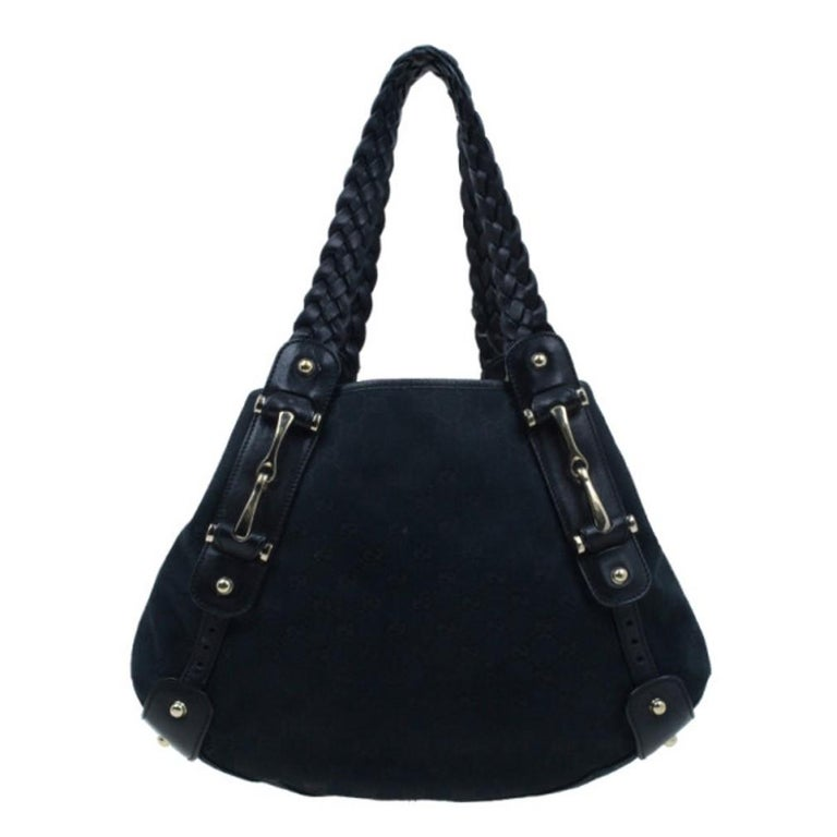 Both stylish and practical, you'll find yourself reaching for Gucci's Pelham to complete all your casual outfits. The exterior is made from monogram canvas that is accented with gorgeous black leather trim and braided shoulder straps. It also