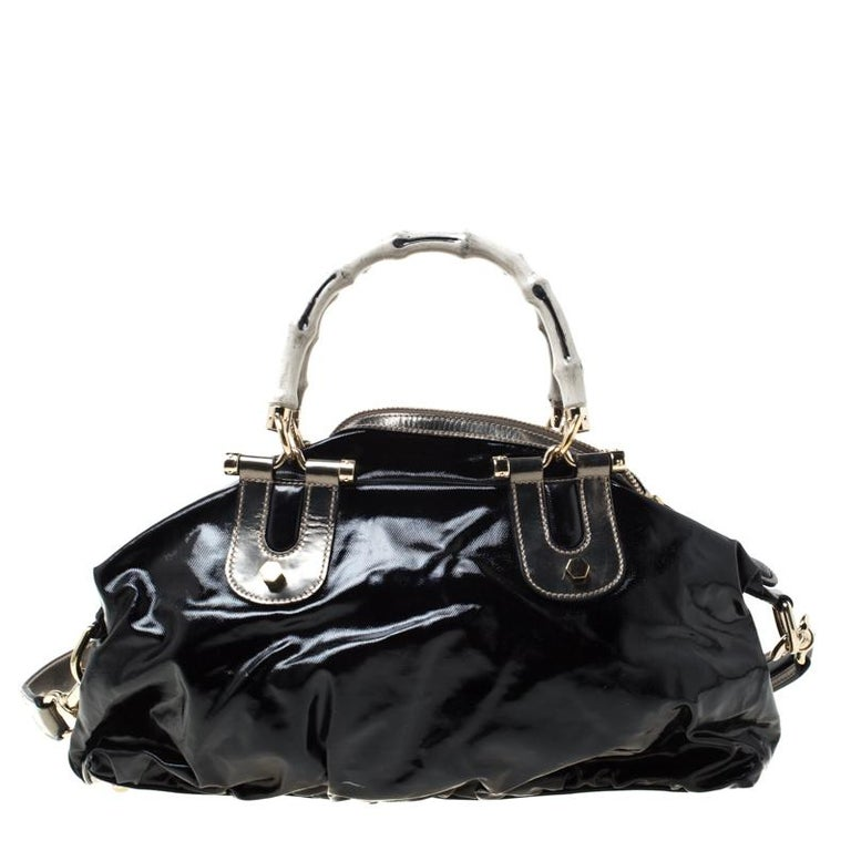 Handbags as fabulous as this one are hard to come by. So, own this gorgeous Gucci Pop Bamboo bag today and light up your closet! Crafted from coated canvas and leather, this stunning number has protective metal feet and a top zipper that opens to a