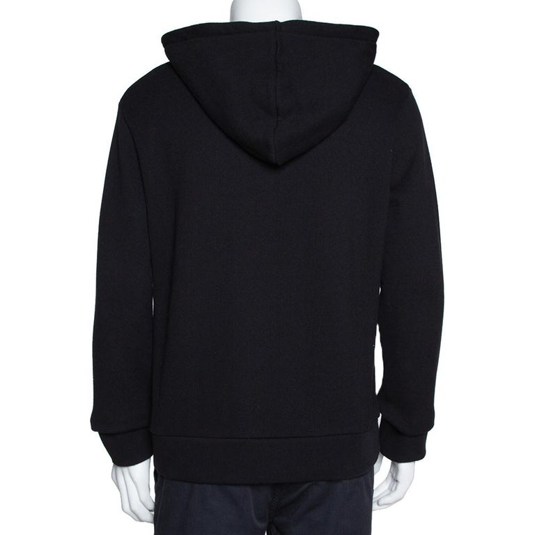 This sweatshirt by Gucci is a closet staple. Crafted from 100% cotton, it comes in black. This creation has a hoodie, web trim at the neckline, and long sleeves. It has been cut to deliver a comfortable fit and will make sure you feel fashionable