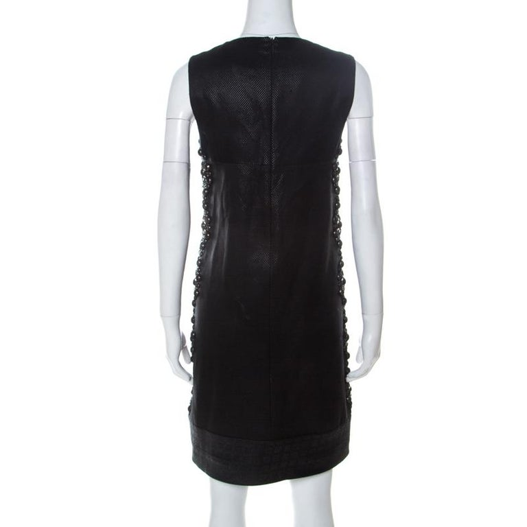 Dress up in this Gucci dress and experience style like never before. The black dress is sleeveless and it features embellishments on the sides and a zip closure. This dress will shine when paired with the right accessories.  Includes: The Luxury