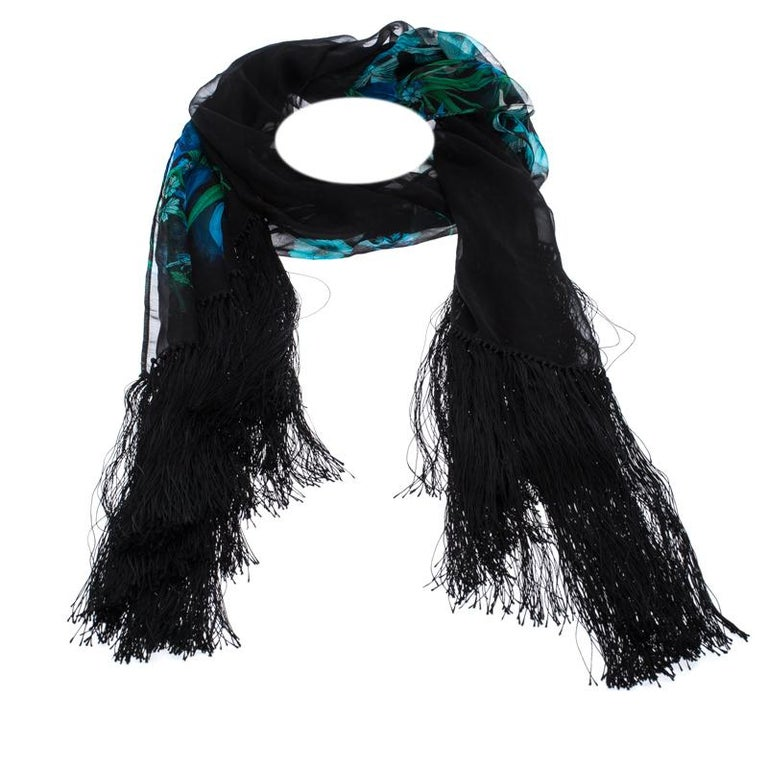 Beautifully cut from silk, this black Gucci scarf features pretty floral prints. It has a soft feel and is finished with fringed edges. Make this gorgeous scarf yours today, and flaunt it like a fashionista!  Includes: The Luxury Closet Packaging