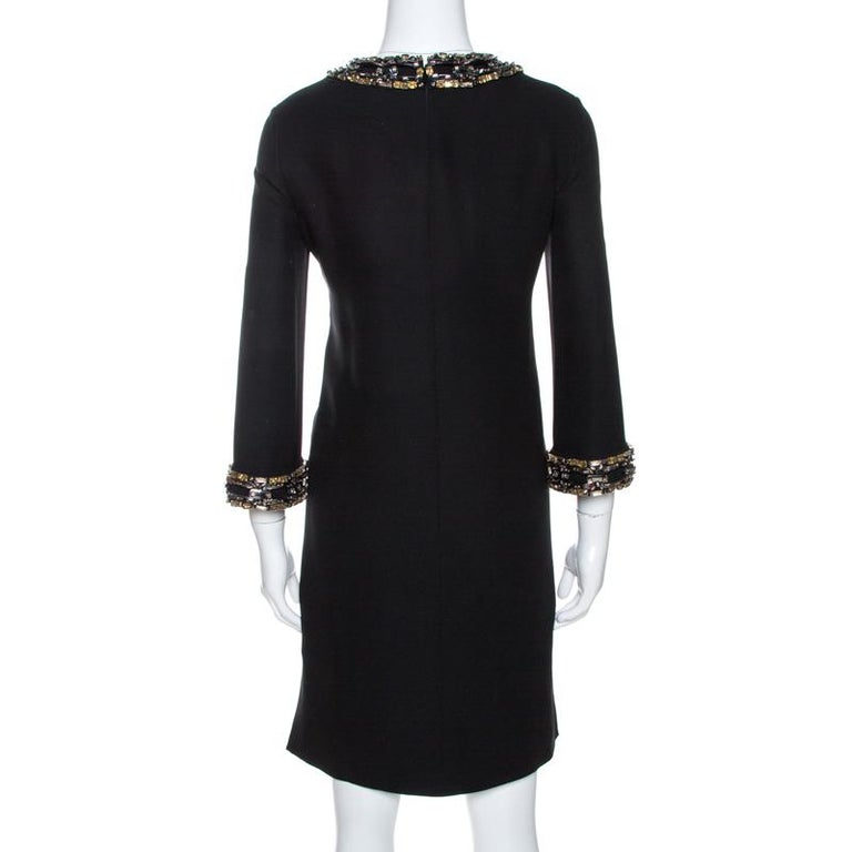 The tailoring of this dress is definite and exquisite making it another perfect creation by Gucci. It comes in black with embellishments on the neckline and sleeves, and a hemline ending above the knees. Make a worthy addition to your collection