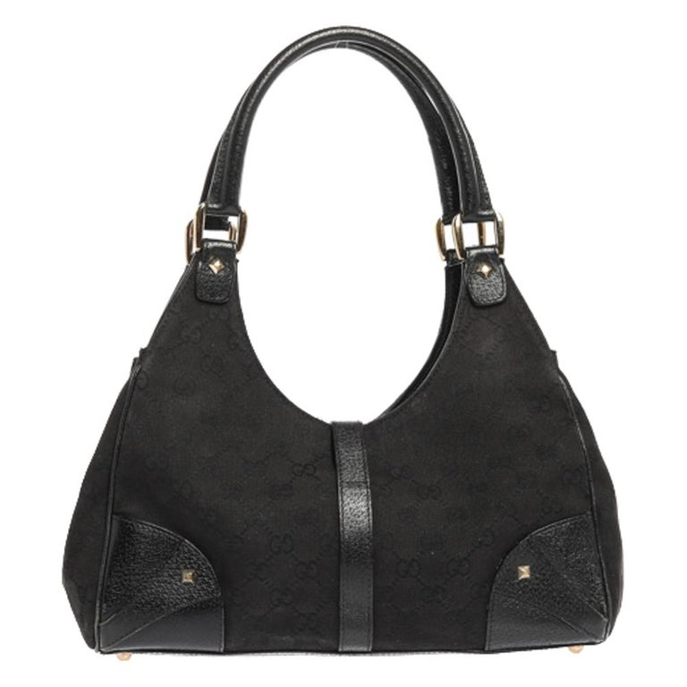 Gucci brings to you this amazing Bardot shoulder bag that is smart and modern. Made in Italy, this bag is crafted from GG canvas & leather and features the signature lock in gold-tone on the front. The fabric-lined interior has enough space to hold