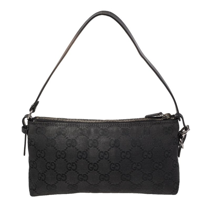 This handy Pochette bag is from the house of Gucci. It has been crafted in Italy and made from signature GG canvas. It comes in a black hue. It is equipped with a fabric interior that will house the essentials you cannot do without. The pochette is