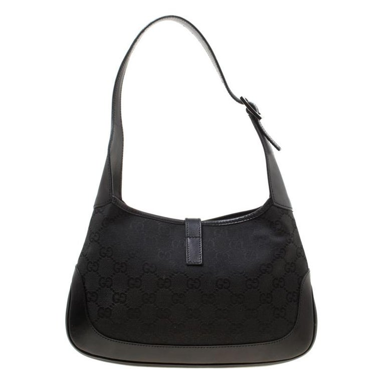 This Gucci bag will never fail you. Crafted from GG canvas in Italy, this gorgeous number has the signature closure that opens up to a spacious fabric interior. Complete with a single handle, this hobo is ideal for everyday use.  Includes: The