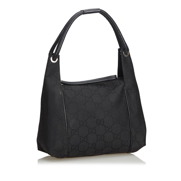 This handbag features a jacquard body, rolled leather handles, top zip closure, and an interior zip pocket. It carries as B+ condition rating.  Inclusions:  This item does not come with inclusions.  Dimensions: Length: 26.00 cm Width: 25.00