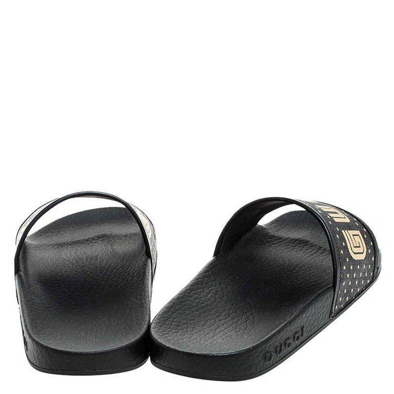 Gucci Black/Gold Coated Canvas Guccy Slip On Slides Size 35 In New Condition For Sale In Dubai, Al Qouz 2