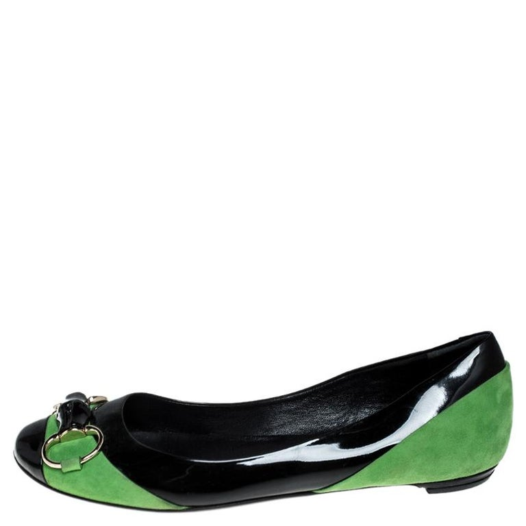 This pair of Gucci's flats combine comfort with style. Crafted from black patent leather and green suede, they feature round toes and Horsebit motifs with bamboo on the uppers. This pair can be teamed up well with casuals.  Includes: The Luxury