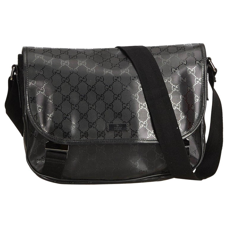 ac4e653d5ab876 Gucci Black Guccissima Imprime Messenger Bag For Sale. This messenger bag  features a PVC body with leather ...