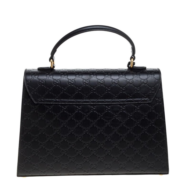 This black bag from Gucci is sure to add sparks of luxury to your wardrobe! It is crafted from the signature Guccissima leather and features a single top handle with an attached clochette. It flaunts a front flap with a gold-tone closure to secure