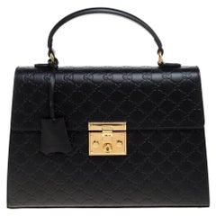 Gucci Black Guccissima Leather Medium Padlock Top Handle Bag