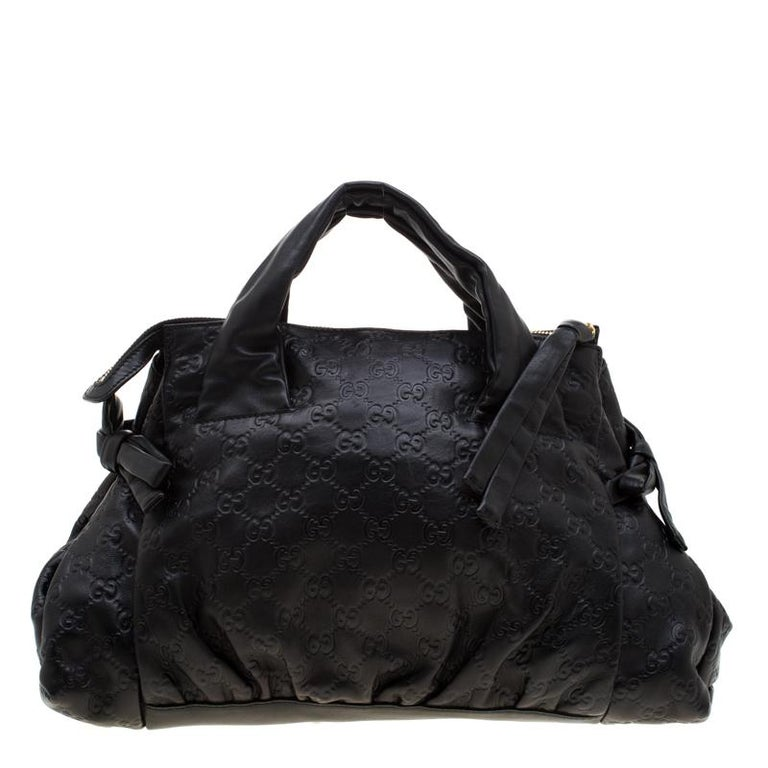This beautiful black satchel will make a fashionable addition to your wardrobe. This small Hysteria satchel by Gucci is made from Guccissima leather and detailed with the Hysteria emblem on the front. The bag has two handles and a roomy interior