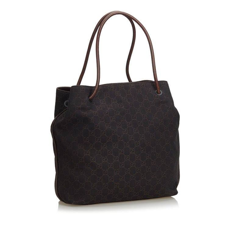 3fab02f9b406 The Gifford tote bag features a jacquard body with leather trim, rolled  leather straps,