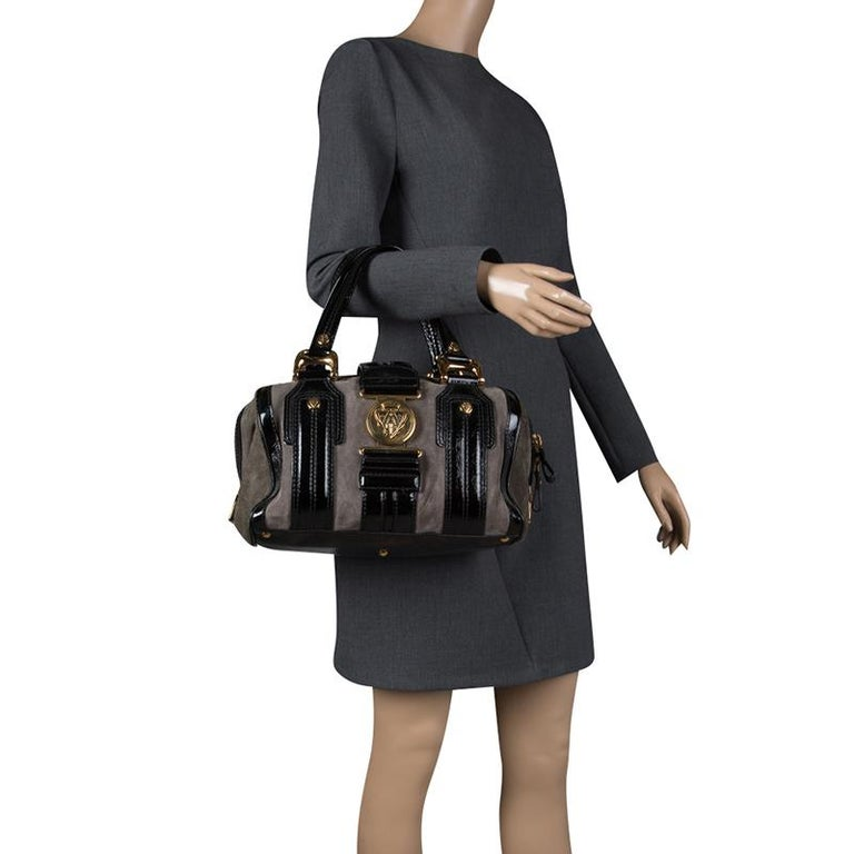 a1d09c0bf5d882 Gucci Black/Khaki Patent Leather and Suede Aviatrix Boston Bag For Sale. A  truly posh and elegant piece to add to your collection. This Boston bag by