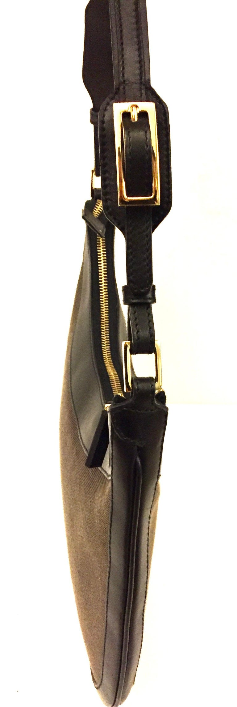 Women's Gucci black leather and brown canvas hobo style bag