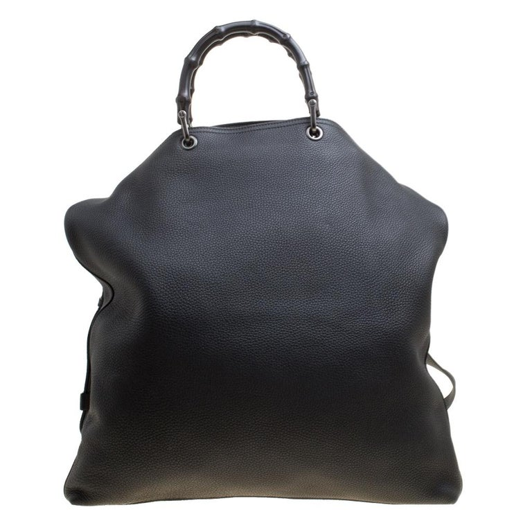 Handbags as fabulous as this one are hard to come by. Crafted from black leather, this stunning number features two bamboo handles and a detachable shoulder strap. The spacious suede interior will safely hold your necessities. The bag is a creation