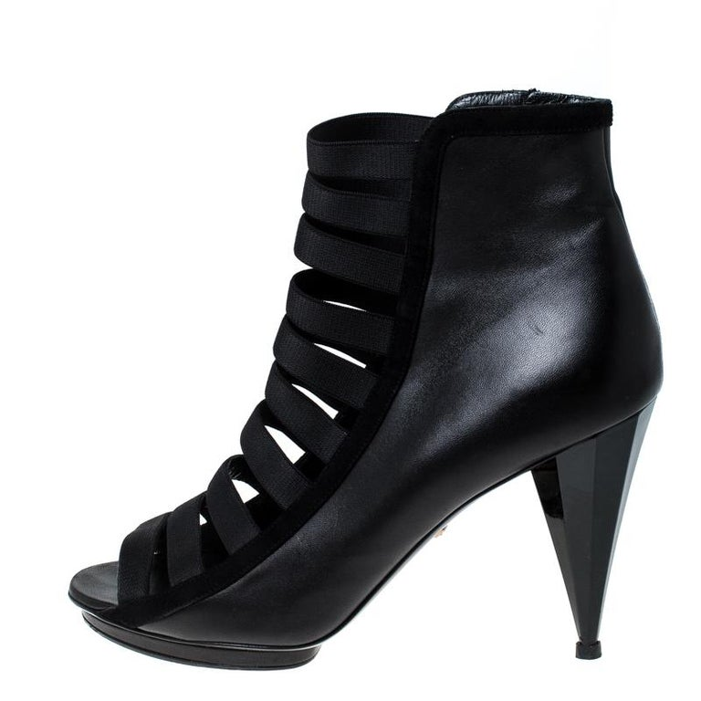 A splendid pair of booties made out of premium quality leather to keep you stylish and comfy. Add a twist to your evening attire with this well-designed pair. The pair carries a cutout design at the vamps and has cone-shaped heels. Complete with