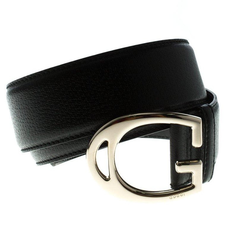 Accessorise with panache using this black G Buckle Belt by Gucci. Made in Italy, the piece is crafted from leather in a beautiful black hue and completed with the well-known G buckle in gold-tone.  Includes: Original Dustbag,Original Box  The Luxury