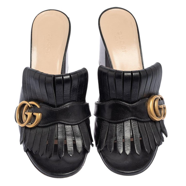 This pair of sandals by Gucci is a buy to wear and treasure. The sandals have been crafted from leather and styled with folded fringes and the brand's signature GG on the uppers. Open toes and a set of block heels complete this classy black pair.