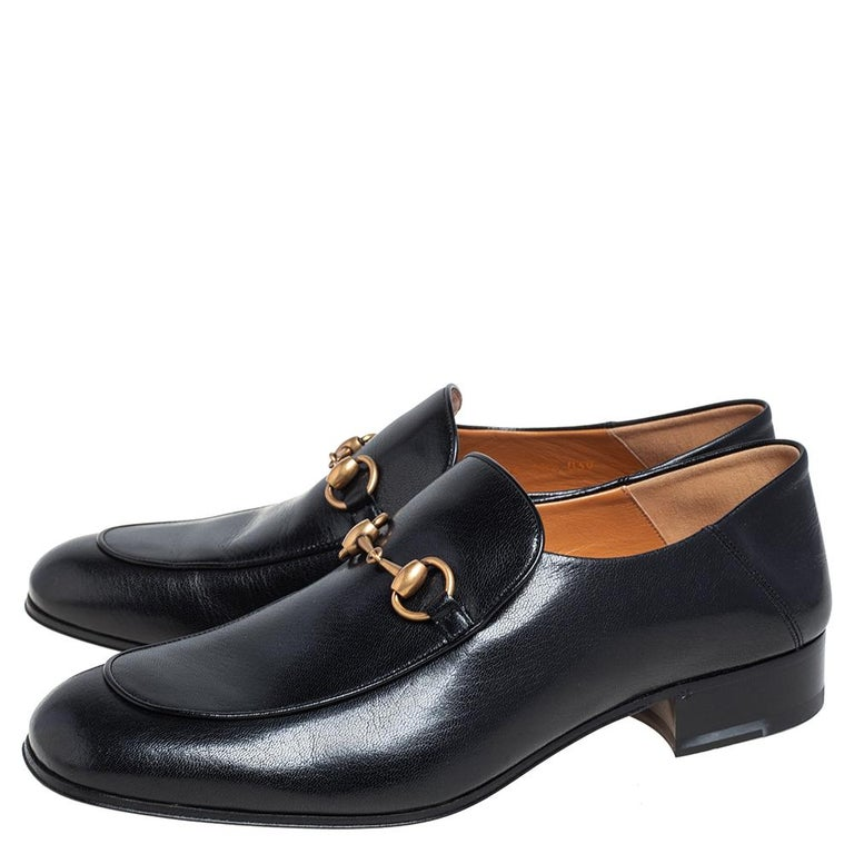 Let comfort and classic style be yours with these designer loafers from Gucci. Crafted in black leather, the high-quality shoes feature Horsebit detailing on the uppers, durable soles, and low heels.  Includes: Original Dustbag, Original Box