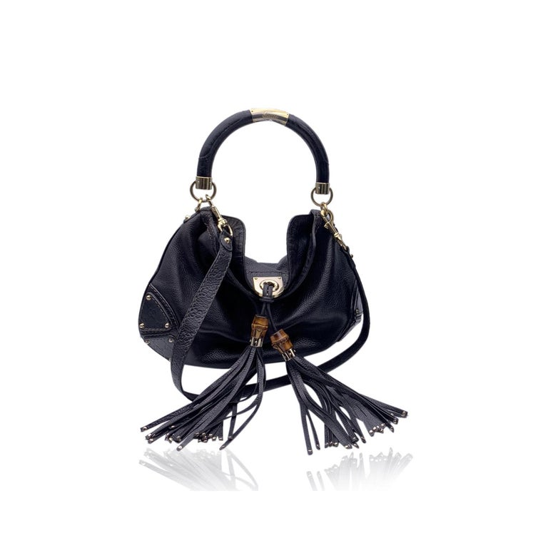 This beautiful Bag will come with a Certificate of Authenticity provided by Entrupy, leading International Fashion Authenticators. The certificate will be provided at no further cost.  Gucci Indy Hobo Bag crafted of black leather. The bag features a