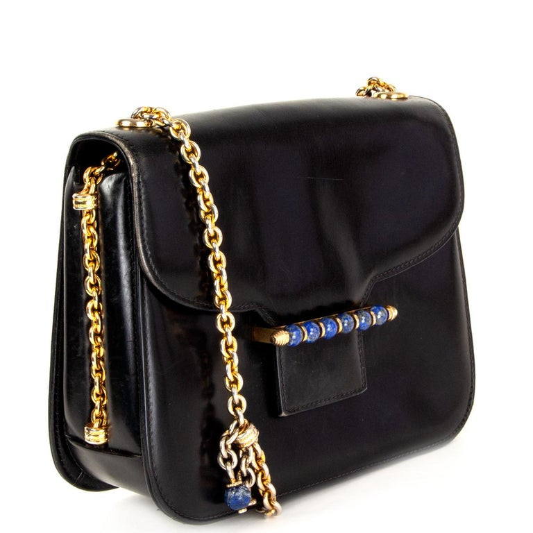100% authentic Gucci Vintage Lapis Lazuli embellished shoulder bag (ca. 1960) in black box leather featuring gold-tone chain shoulder-strap and Lapis Lazuli embellishment at front. Lined in black leather with one zipper pocket against the back, two