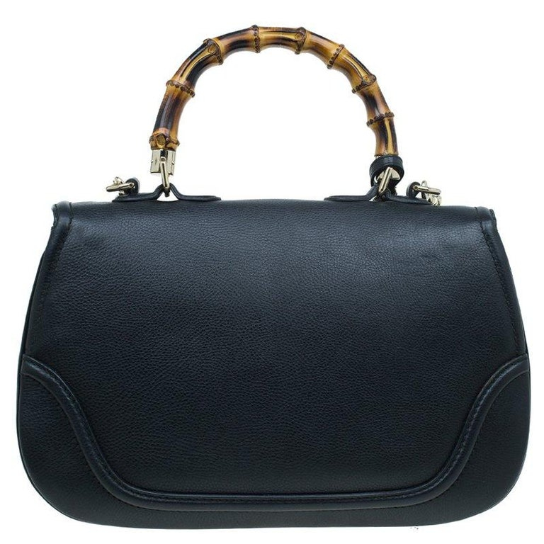 Chic and stylish, this Gucci bag looks distinct with its bamboo-inspired design. Crafted from black leather, it is provided with gold-tone hardware. It features top handle, a detachable shoulder strap, tassels, and a flap closure with bamboo