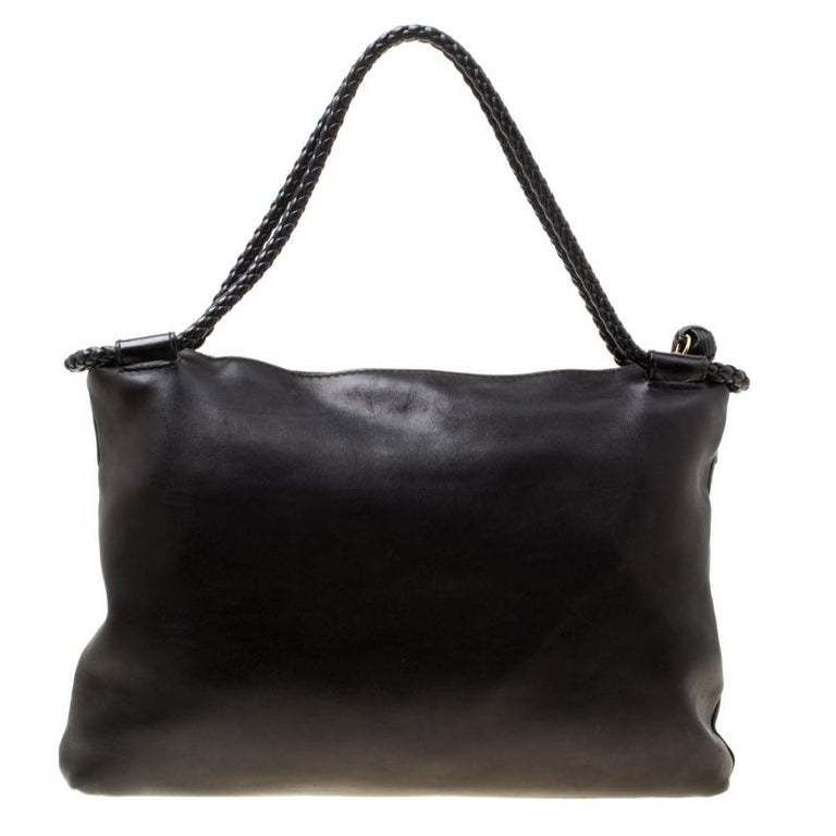 Revamp your wardrobe essentials by adding this fabulous leather handbag to your collection. It is well-crafted and the canvas lined interior is another handy feature. It has two woven handles and weave accents on the front.  Includes: The Luxury