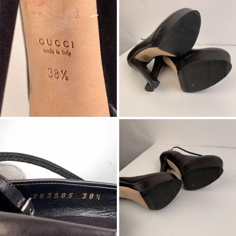 Gucci Platform Pumps, crafted in black leather They featurea removable ankle strap with buckle closure, almond toes and platforms (height 1 inch- 2,5 cm. Covered heels (6 inches - 15,2 cm ). Rubber outsoles. Size: EU 38.5 (The size shown for this