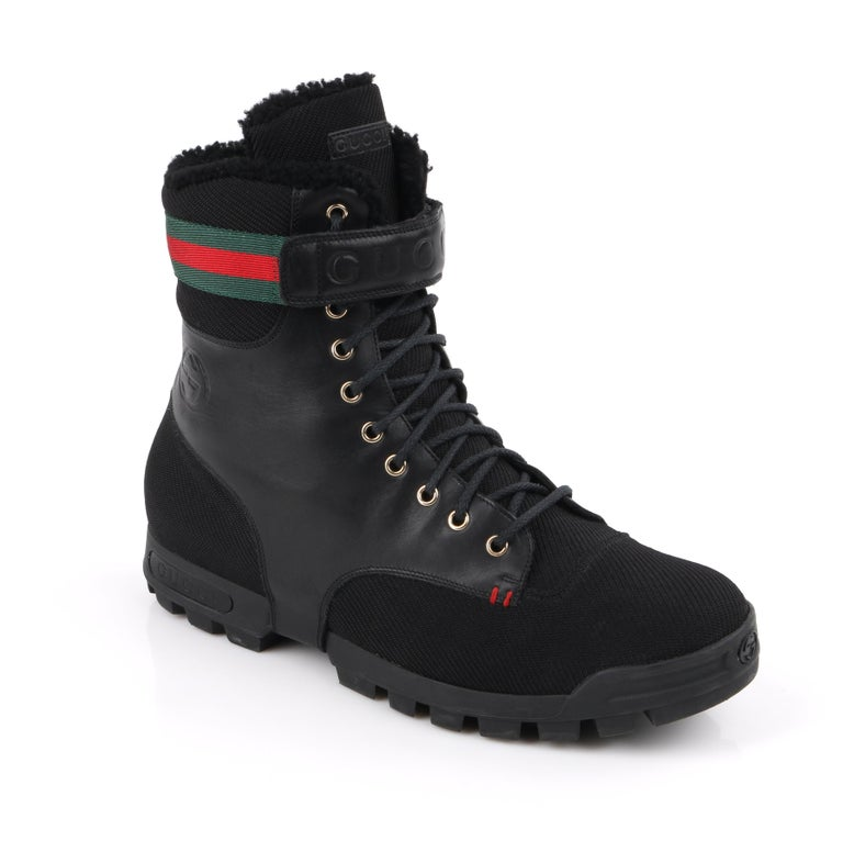 DESCRIPTION: GUCCI Black Leather Signature Webbing Shearling Lined Combat Boots   Brand / Manufacturer: Gucci Collection:  Designer: Manufacturer Style Name:  Style: Combat boots Color(s): Black, green, and red Marked Materials: Upper: Leather and