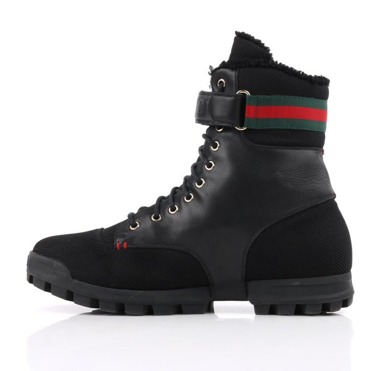 GUCCI Black Leather Signature Webbing Shearling Lined Combat Boots In Good Condition For Sale In Thiensville, WI