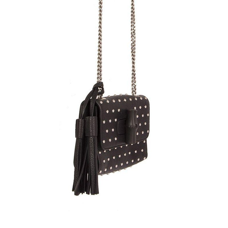 Gucci 'Studded Miss Bamboo Small' shoulder bag in black leather with tassel. Bamboo turn-lock closure. Lined in dark taupe leather with an open pocket against the back. Has been carried and is in virtually new condition.  Height 12cm (4.7in) Width