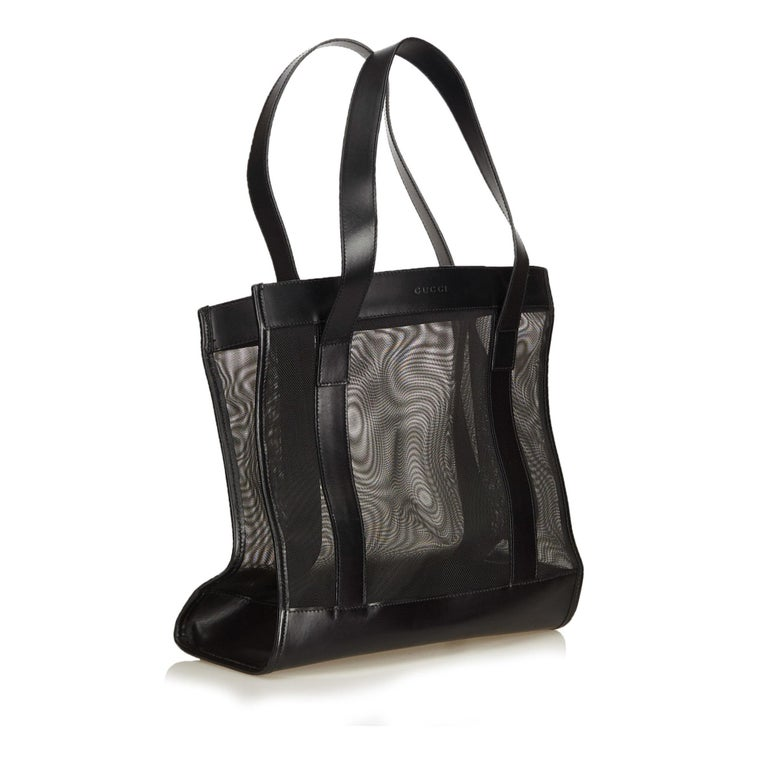 This tote bag features a mesh body, flat leather straps, and an open top. It carries as AB condition rating.  Inclusions:  This item does not come with inclusions.  Dimensions: Length: 27.00 cm Width: 26.00 cm Depth: 12.00 cm Shoulder Drop: 19.00