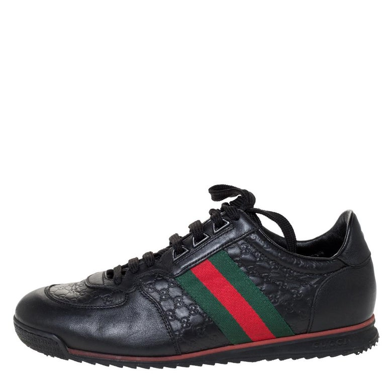 Step into these Gucci sneakers for instant comfort! They feature the iconic Gucci Web detail on the Microguccissima leather exterior. They are lined with leather and finished with lace-ups and rubber soles. Pair these with practical casuals for a