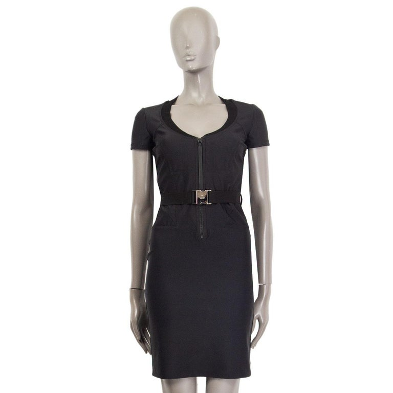100% authentic Gucci neoprene sheath dress in black missing tag (probably viscose). With a close fit, detailed seams, ribbed neckline, short sleeves and a waist-belt. Closes with a zipper in the front. Has been worn and is in excellent