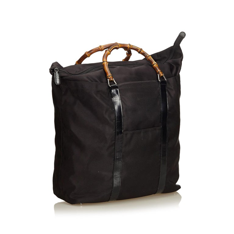 This handbag features a nylon body, bamboo handles, top zip closure, exterior slip pocket, and an interior zip pocket. It carries as B+ condition rating.  Inclusions:  This item does not come with inclusions.  Dimensions: Length: 36.00 cm Width: