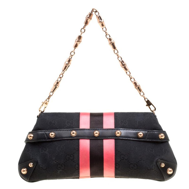 One look at this clutch from Gucci and you will know right away why it is luxury. Crafted from classic GG canvas and styled with pink satin trims, this piece is held by a chain with bamboo accents. The front features their Horsebit accent and it