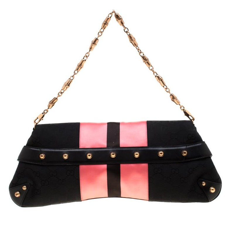 One look at this clutch from Gucci and you will know right away why it is luxury. It is from a limited edition series of designs by Tom Ford for Gucci. Crafted from classic GG canvas and styled with pink satin trims, this piece is held by a chain