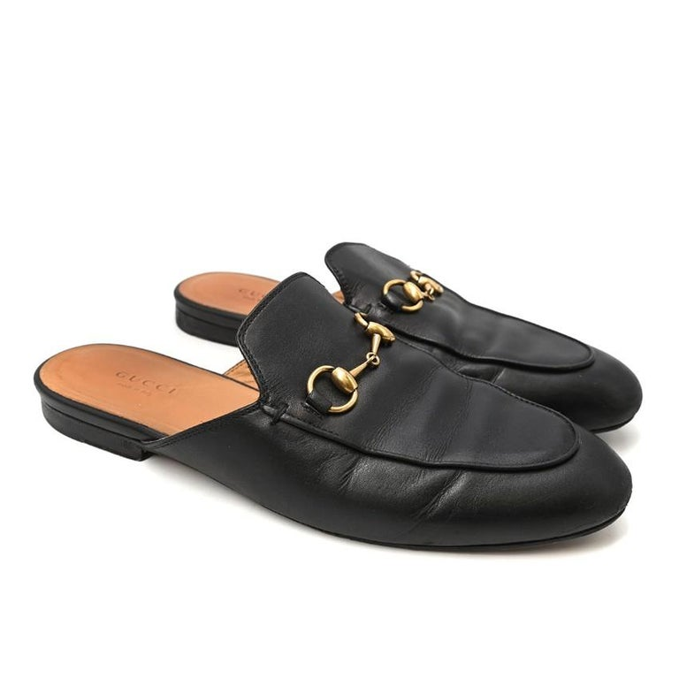 Gucci Black Princeton Horsebit Leather Backless Loafer  - Cult Princeton shape - Features signature Gucci gold-tone horsebit - Backless slip-on style - Almond toe - Low stacked heel  Materials: Leather  Made in Italy  Please note, these items are