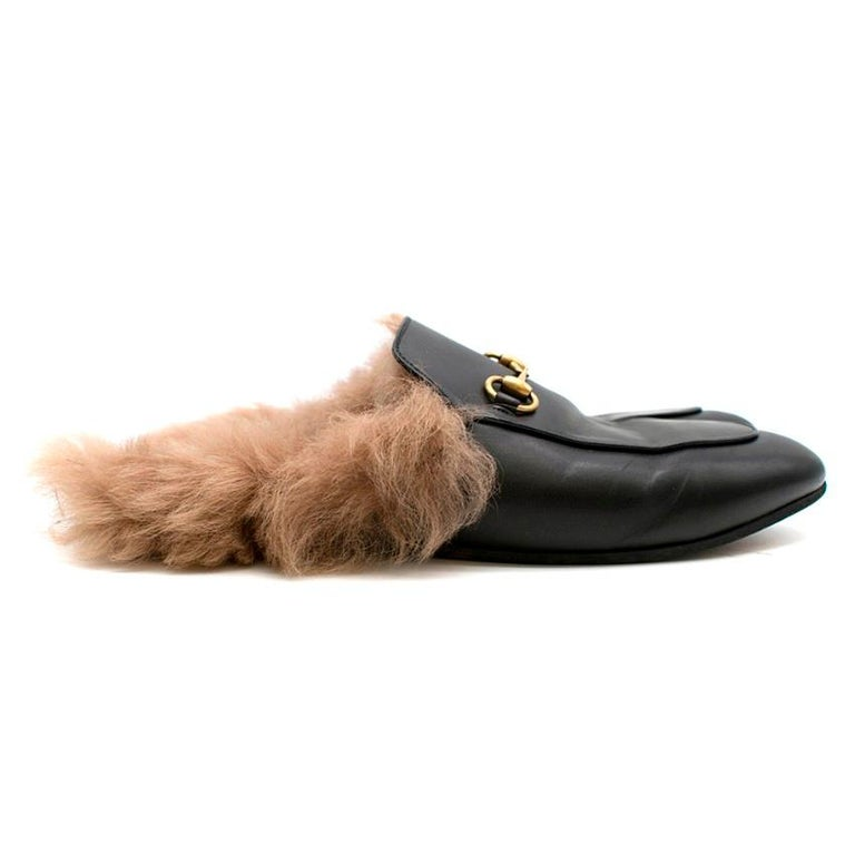 Black Princetown Leather Fur Lined Mules  - Fur lined - Backless slide on - Gold-tone signature horse-bit  - Rounded toe  - Small stacked heel    Made in Italy  Materials  Outer: Leather 100% Sole: Leather 100% Lining: Lamb Fur 100%  Please note,
