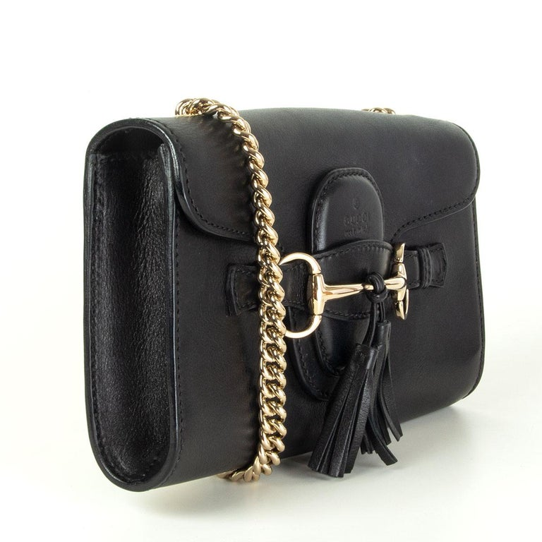 Gucci Emily shoulder bag in black calfskin with tassel and horsebit buckle detail in light gold-tone. Lined in black leather with one open pocket against the back. Has been worn and is in excellent condition. Comes with dust bag.   Height 15cm