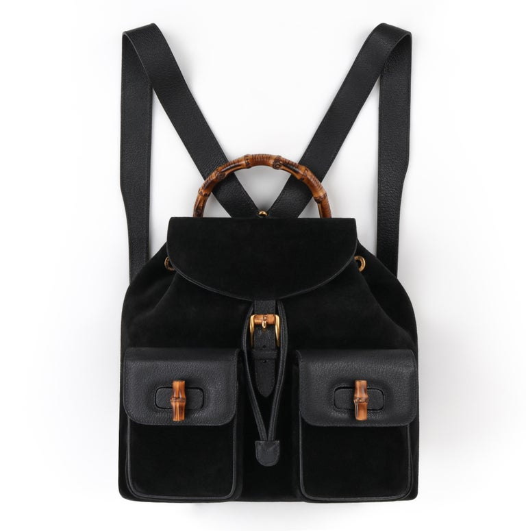 Classic luxury GUCCI two pocket backpack with iconic bamboo details!  GUCCI Black Suede/Leather Drawstring Bamboo Handle Two Pocket Backpack Handbag  Estimated Retail: $2,500   Labels: Gucci Style: Backpack Color(s): Black Lined: Yes Unmarked Fabric