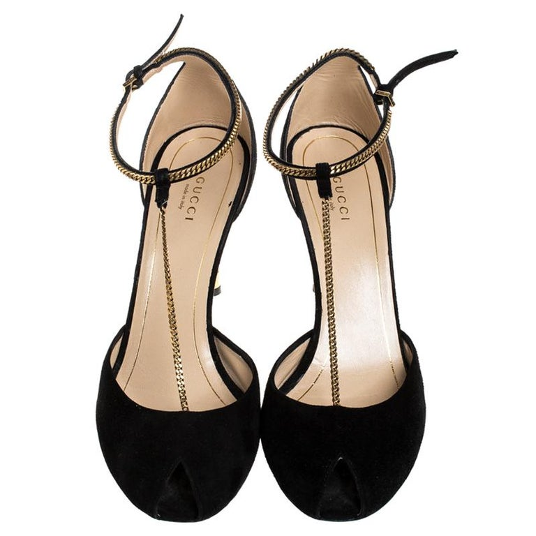 Gucci's urban and gorgeous Ophelie Chain detail sandals are classy. Crafted in black suede, they feature impressive chain details along with buckle fastenings at the ankle strap. The pair is accented with gold-tone hardware and comes with 9.5