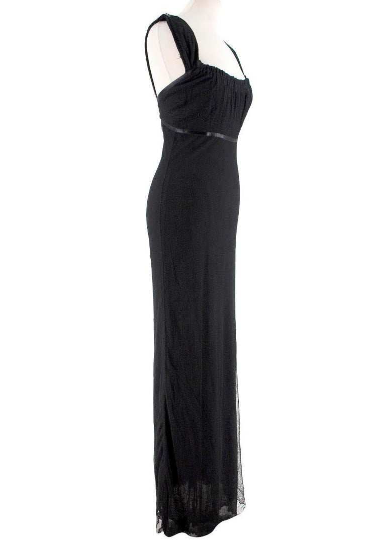 Gucci black-tulle gown  - Black, tulle - Square gathered elasticated neckline, wide shoulder straps  - Empire waist, black satin trim  - Black black satin bow  - Concealed side-zip fastening  - Black jersey lining    100% viscose.  This item has no