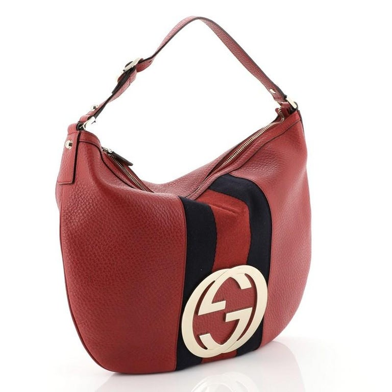 This Gucci Blondie Web Hobo Leather Large, crafted in red leather, features a large gold interlocking Gucci GG logo at its center, leather shoulder strap, signature Gucci Web stripes and gold-tone hardware. Its top zip closure opens to a black
